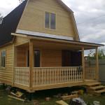 Дом из бруса на свайном фундаменте